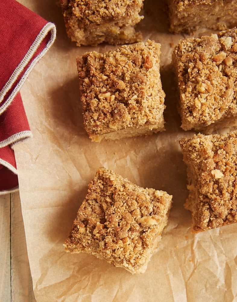 overhead view of Caramel Apple Crumb Cake slices on parchment paper