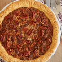Classic pecan pie gets even better and more flavorful in this Chocolate Chip Coconut Pecan Pie! - Bake or Break