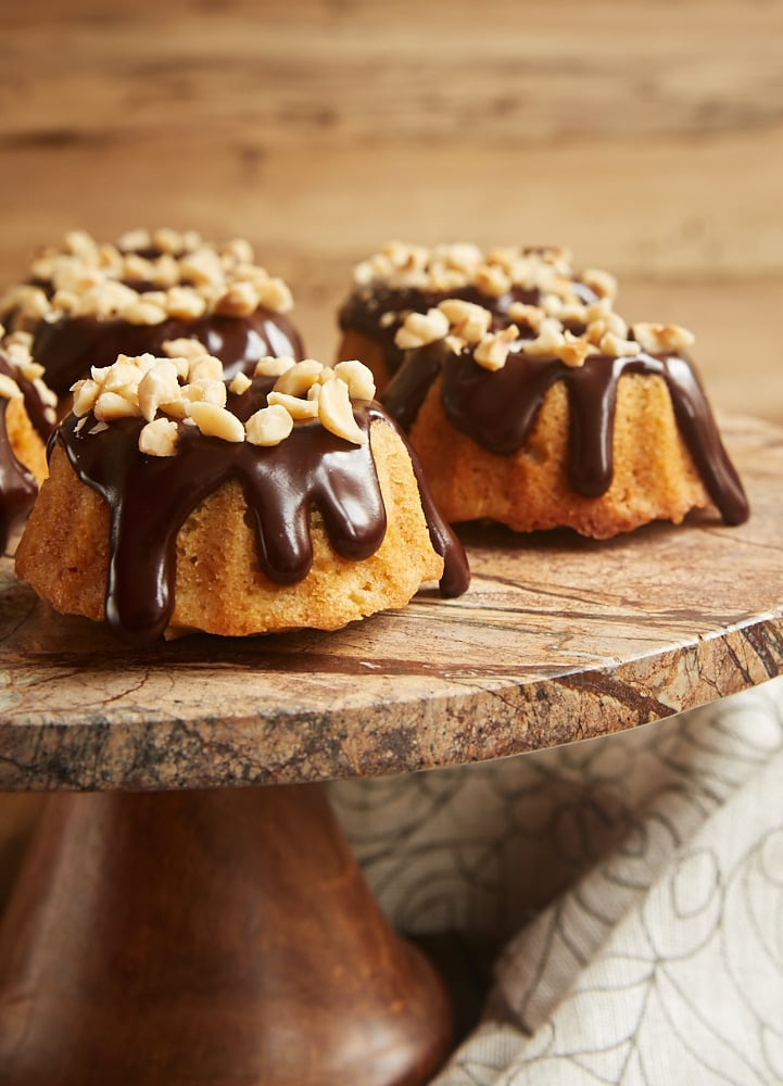 Brown Butter Hazelnut Bundt Cakes served on a dark marble cake stand