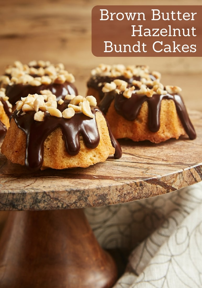 Brown Butter Hazelnut Bundt Cakes are little treats with big flavor. Toasted hazelnuts, browned butter, and dark chocolate ganache combine for an irresistibly delicious dessert! - Bake or Break