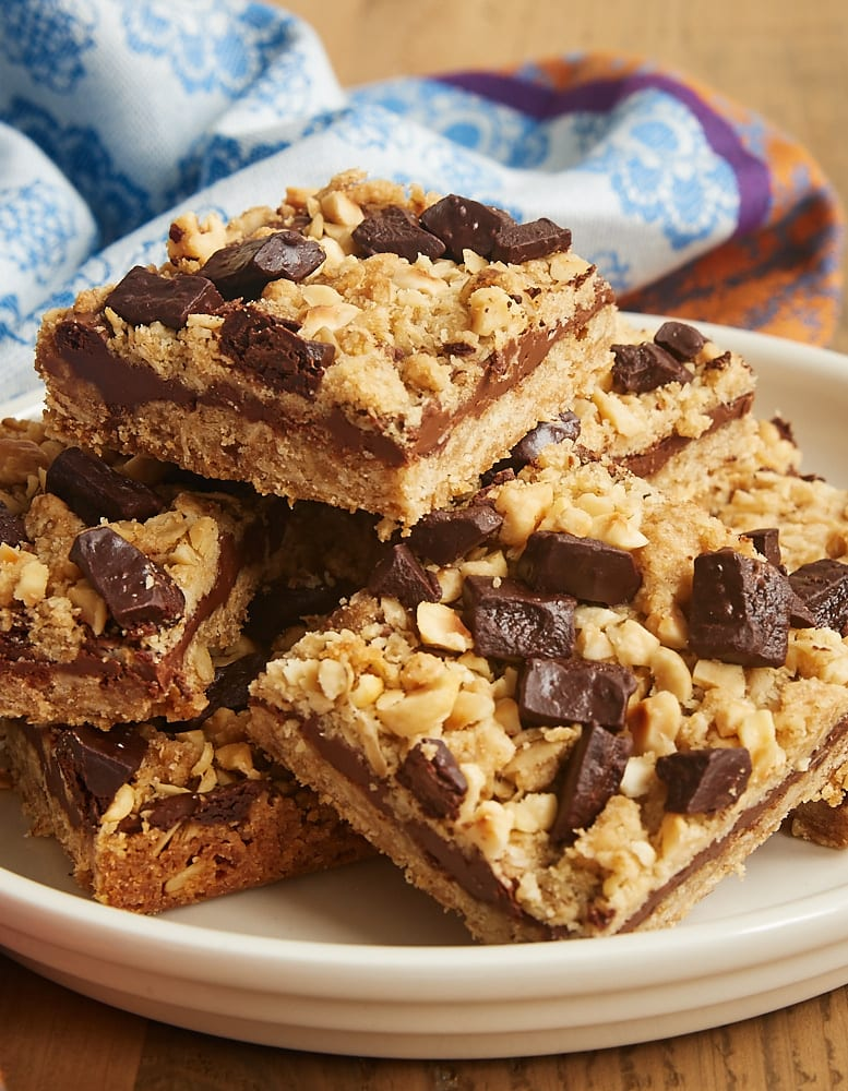 Chocolate Hazelnut Oat Bars stacked on a white plate