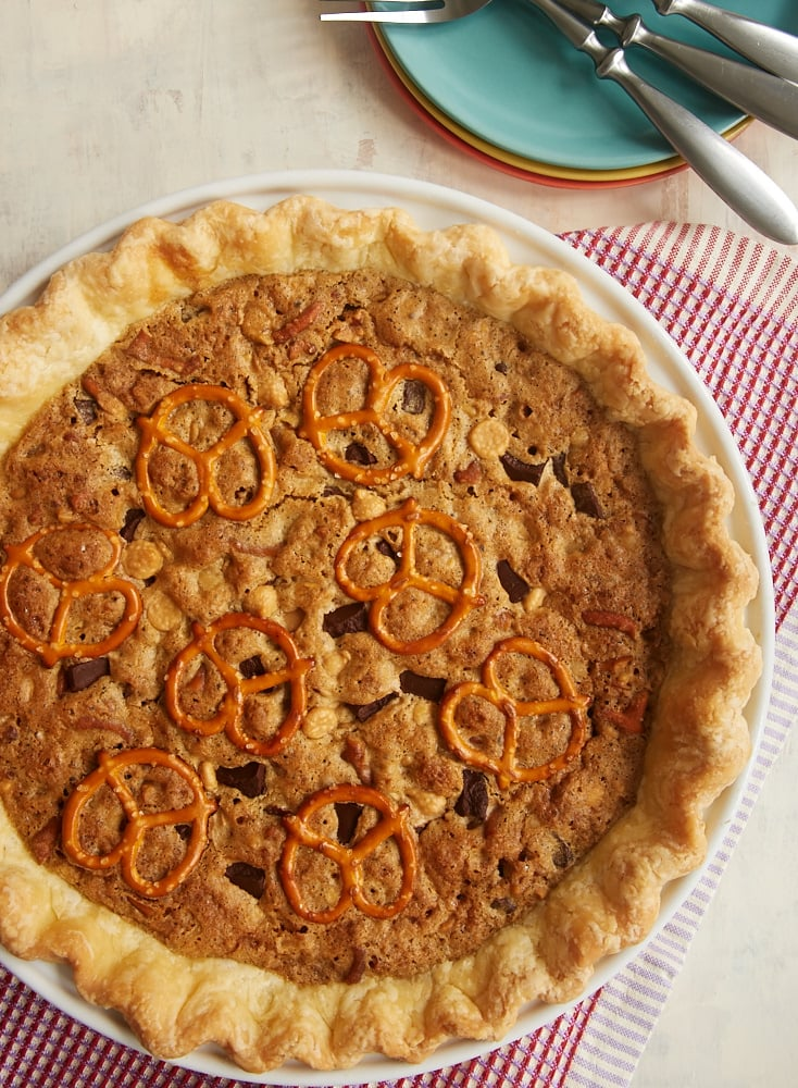 Monster Cookie Pie is jam-packed with all your favorite flavors. Such a fun dessert! - Bake or Break