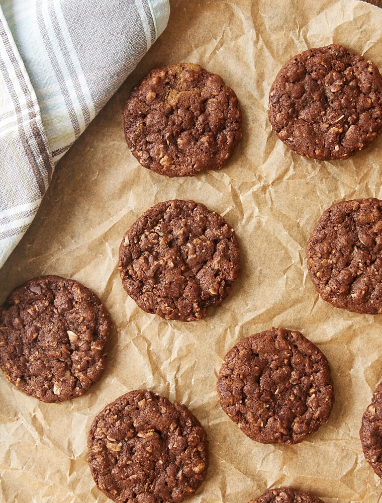 overhead view of Chocolate Oatmeal Biscoff Cookies on parchment paper
