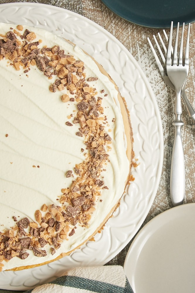 overhead view of Brown Sugar Caramel Cheesecake with Oatmeal Cookie Crust on a round white serving tray
