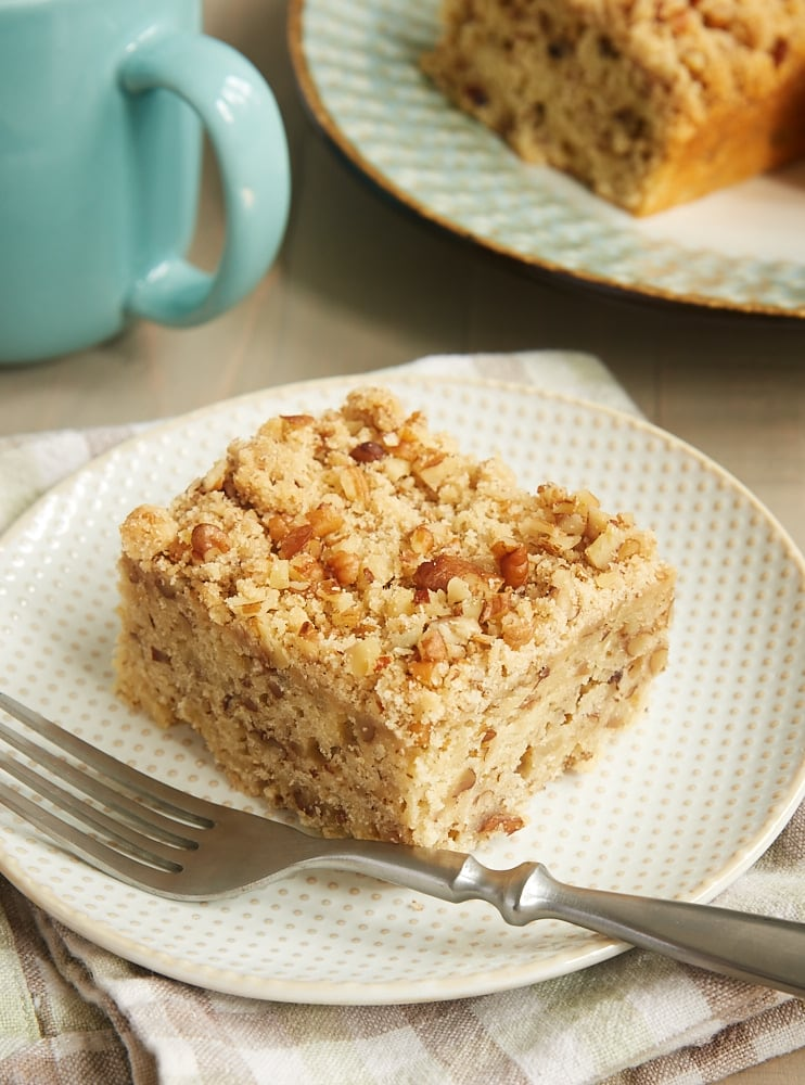 slice of Brown Sugar Pecan Coffee Cake on a beige and white plate