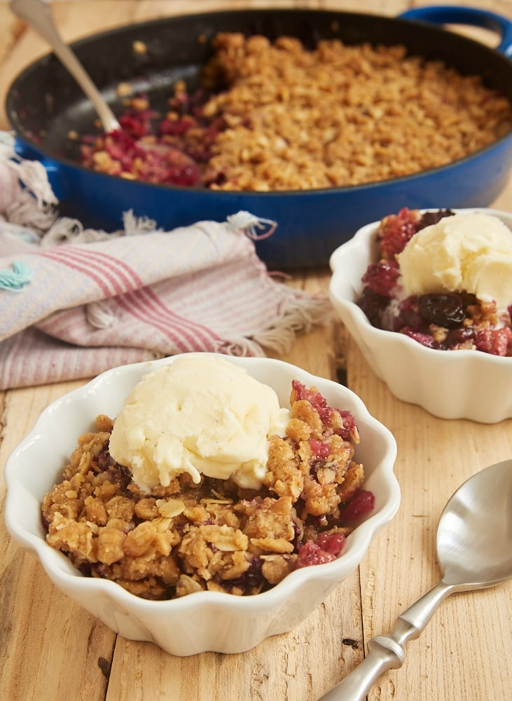 servings of Skillet Berry Crumble topped with ice cream