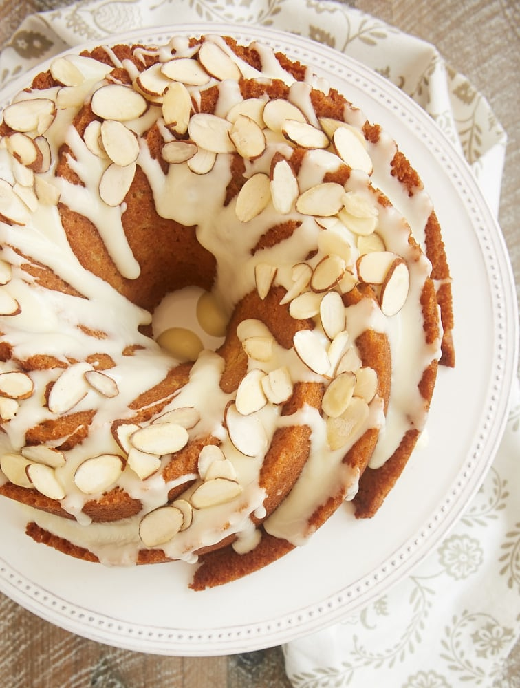 Amaretto Almond Bundt Cake topped with an almond glaze and sliced almonds