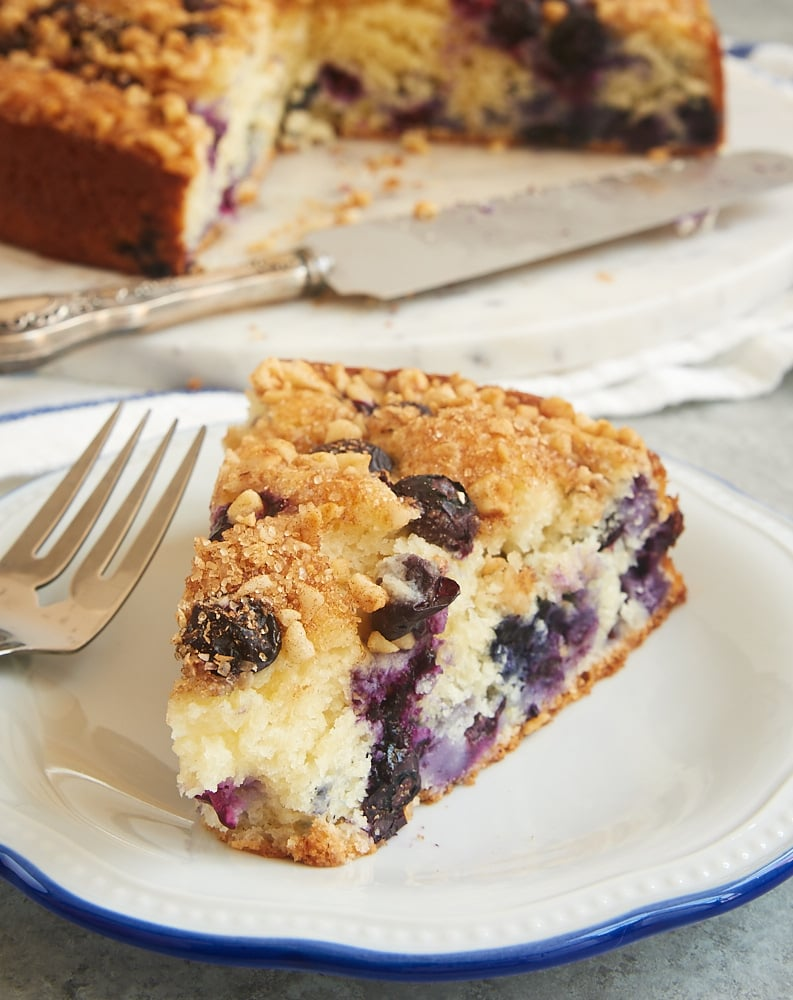 slice of Blueberry Coffee Cake on a blue-rimmed white plate