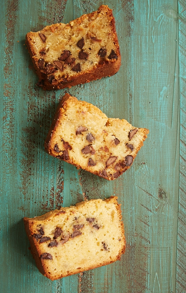 three slices of Chocolate Chip Cream Cheese Pound Cake on a green wooden surface