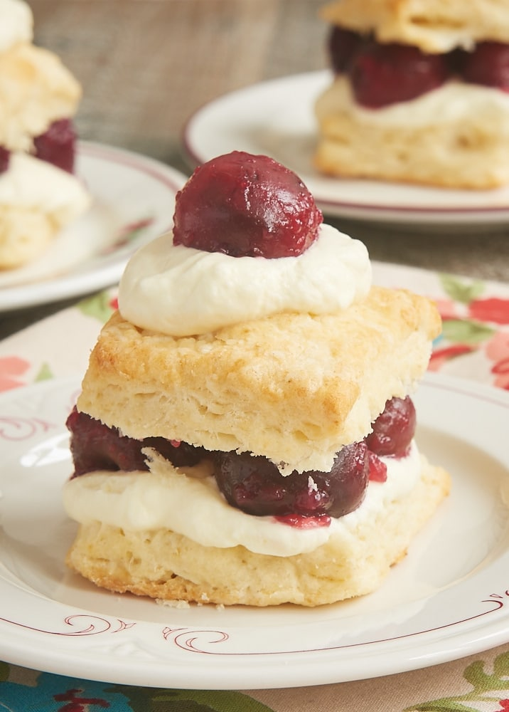 Cherry Shortcake made with Cream Cheese Biscuits and topped with sweetened whipped cream