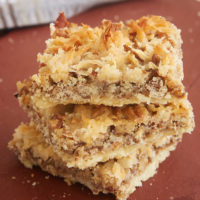 stack of Coconut Pecan Shortbread Squares on a cutting board