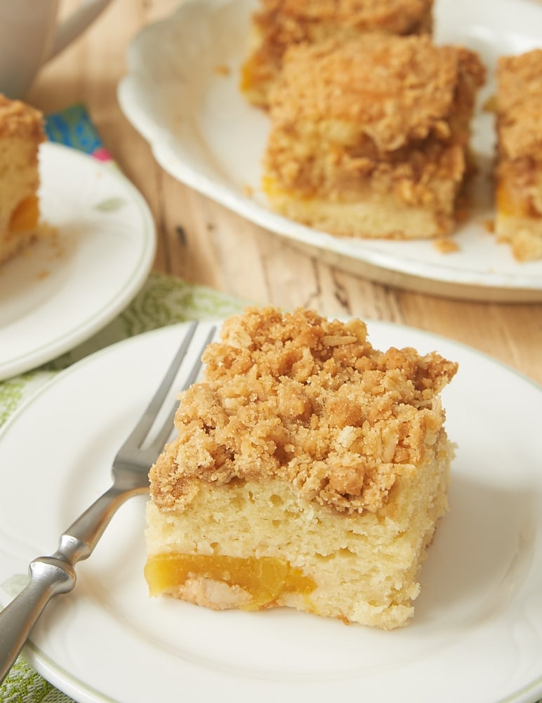 slice of Peach Cobbler Coffee Cake on a white plate