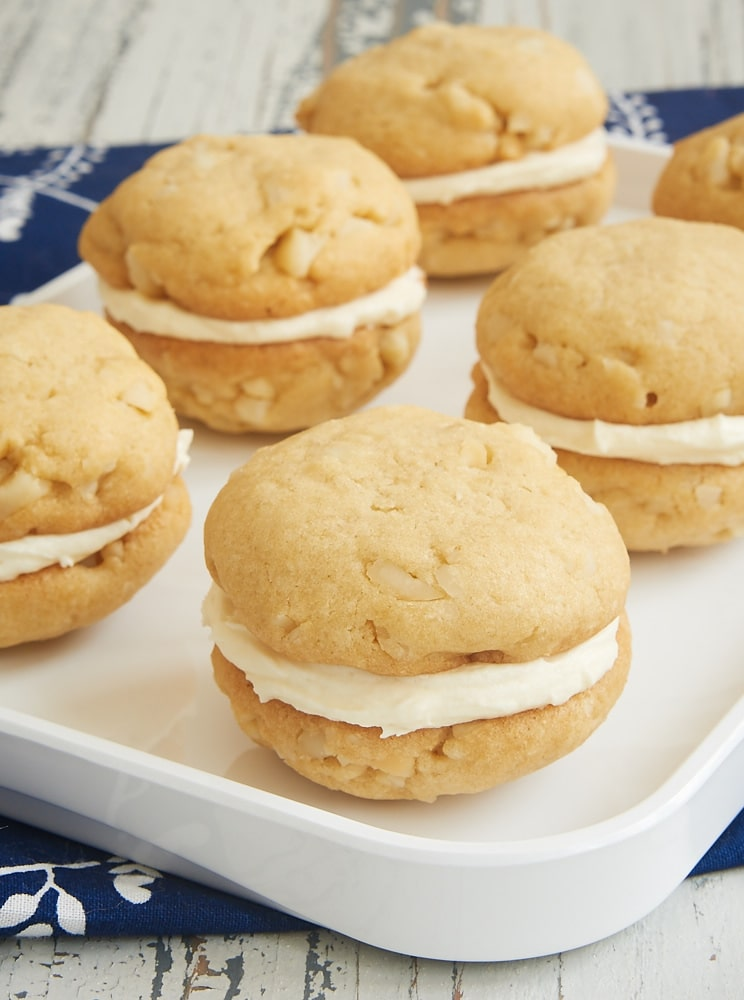 White Chocolate Macadamia Sandwich Cookies on a white tray