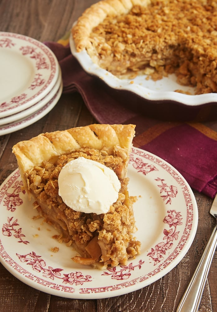 slice of Apple Crumb Pie topped with sweetened whipped cream