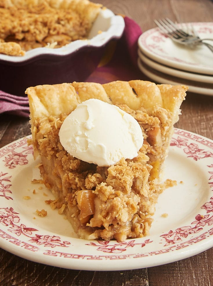 Apple Crumb Pie topped with sweetened whipped cream