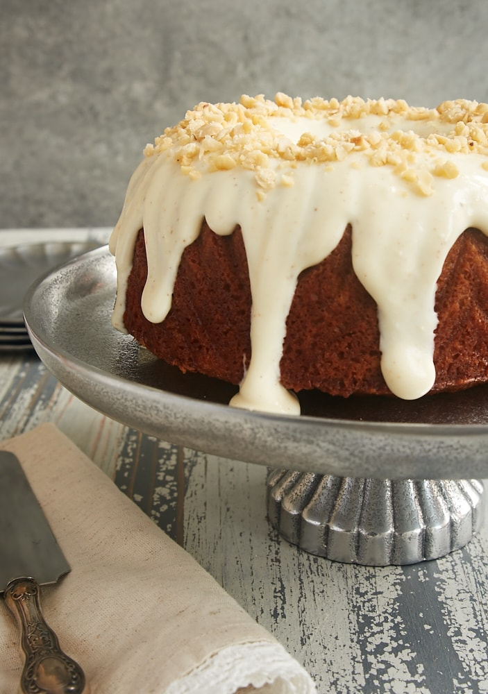 Cinnamon Hazelnut Bundt Cake with Brown Butter Glaze on a pewter cake plate
