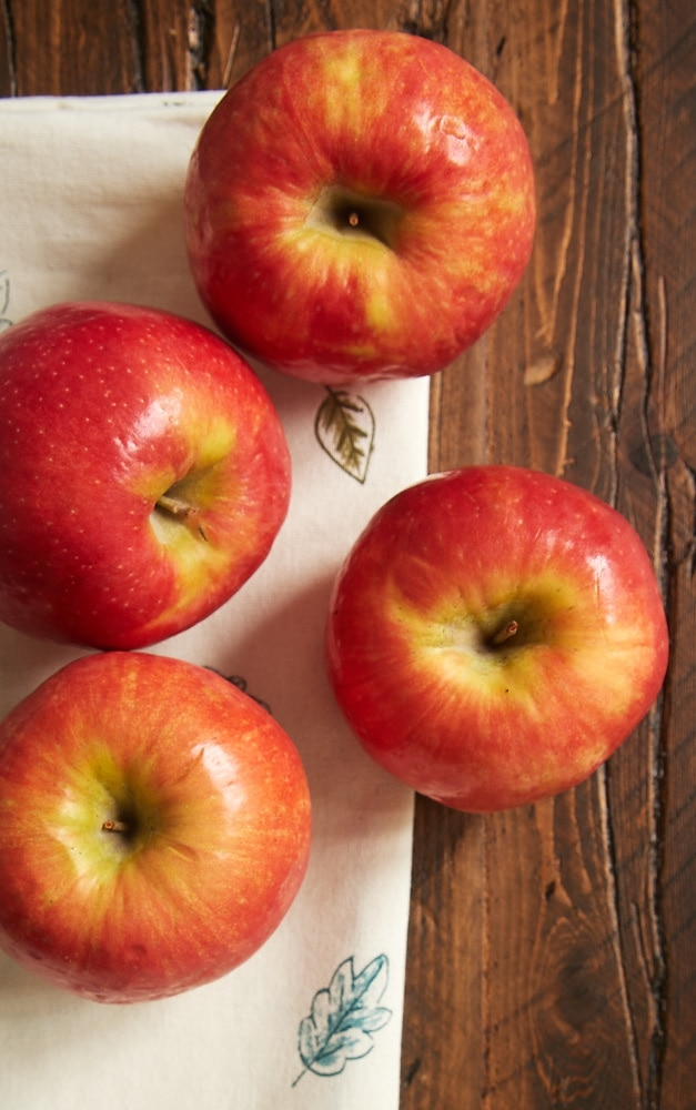 overhead view of apples on a wooden surface
