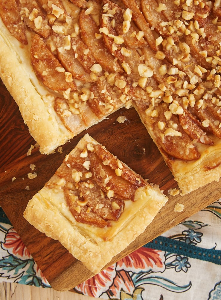 overhead view of Cream Cheese-Filled Pear Tart on a wooden cutting board