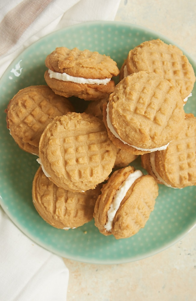 overhead view of Peanut Butter Marshmallow Sandwich Cookies on a green plate