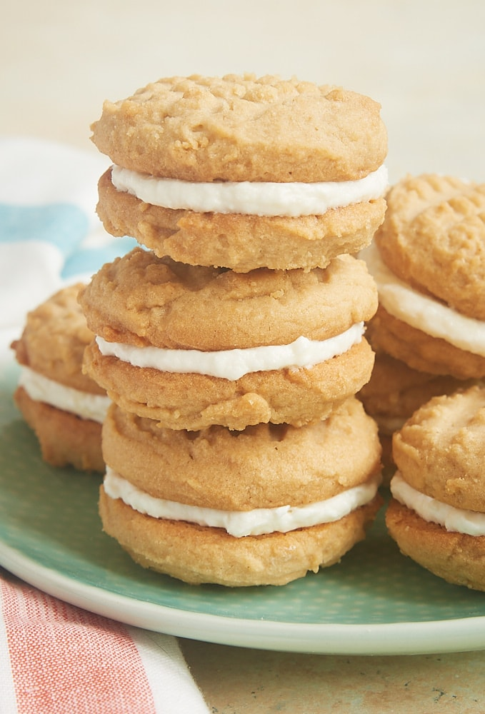 Peanut Butter Marshmallow Sandwich Cookies stacked on a green plate