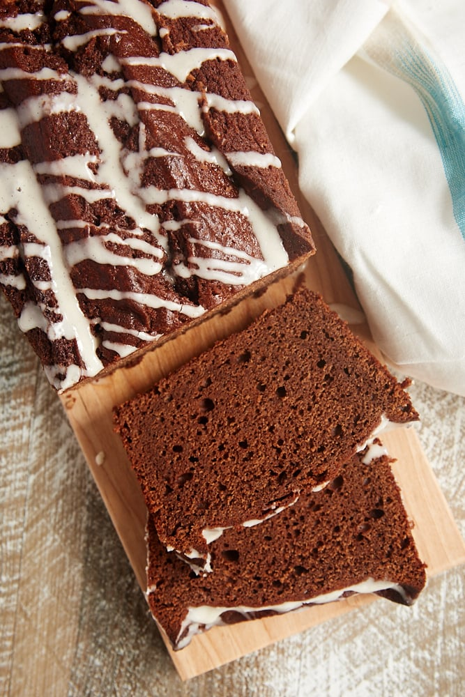 slices of Chocolate Pound Cake with Vanilla Bean Glaze on a cutting board