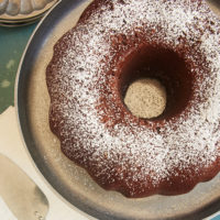 overhead view of Buttermilk Mexican Chocolate Pound Cake dusted with confectioners' sugar