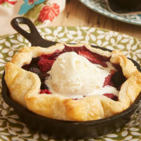 Mini Skillet Mixed Berry Pies topped with ice cream
