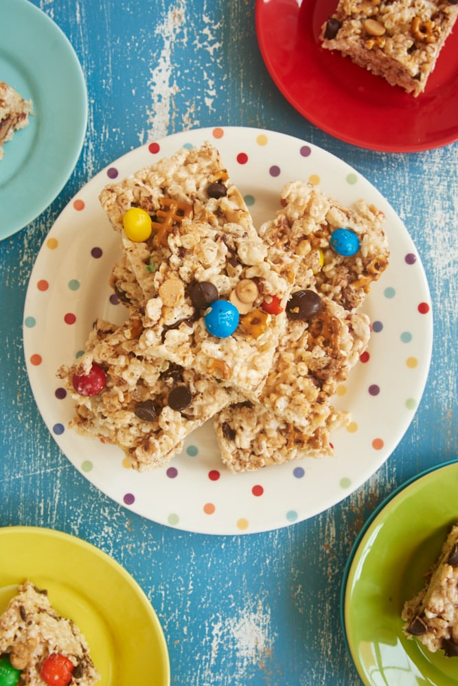 Kitchen Sink Rice Crispy Treats stacked on a plate