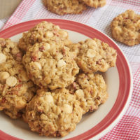 Strawberry White Chocolate Oatmeal Cookies on a red-rimmed plate