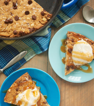 Brown Butter Skillet Blondie served with ice cream and caramel sauce
