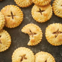 Pecan Hand Pies on a dark surface