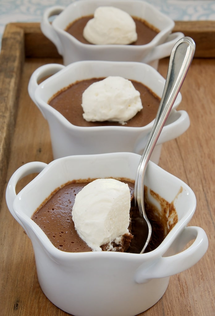 Chocolate Pots de Creme topped with whipped cream