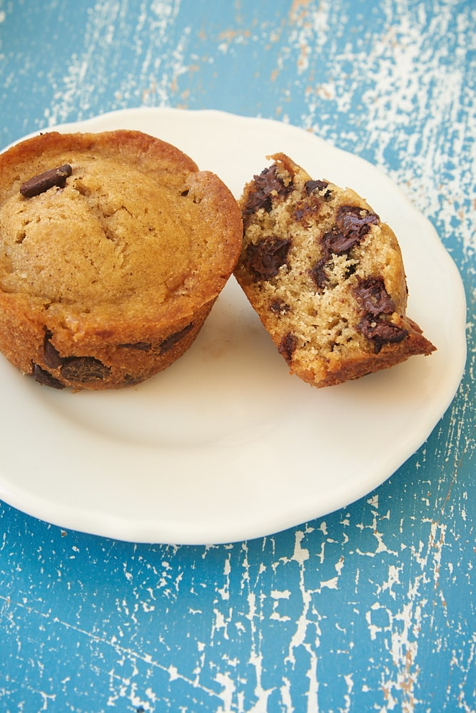 two Chocolate Chip Muffins on a white plate