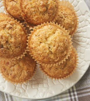 Brown Butter Coconut Pecan Muffins on a white plate