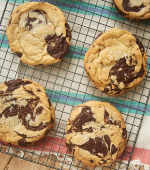 Jacques Torres Chocolate Chip Cookies on a wire cooling rack