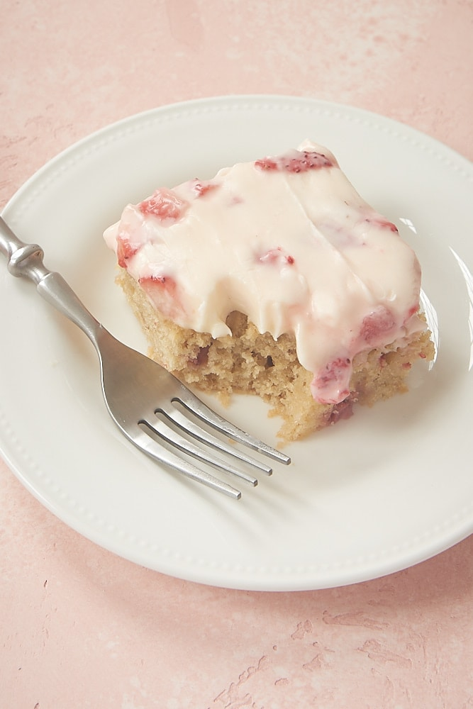 Strawberry Sheet Cake served on a white plate