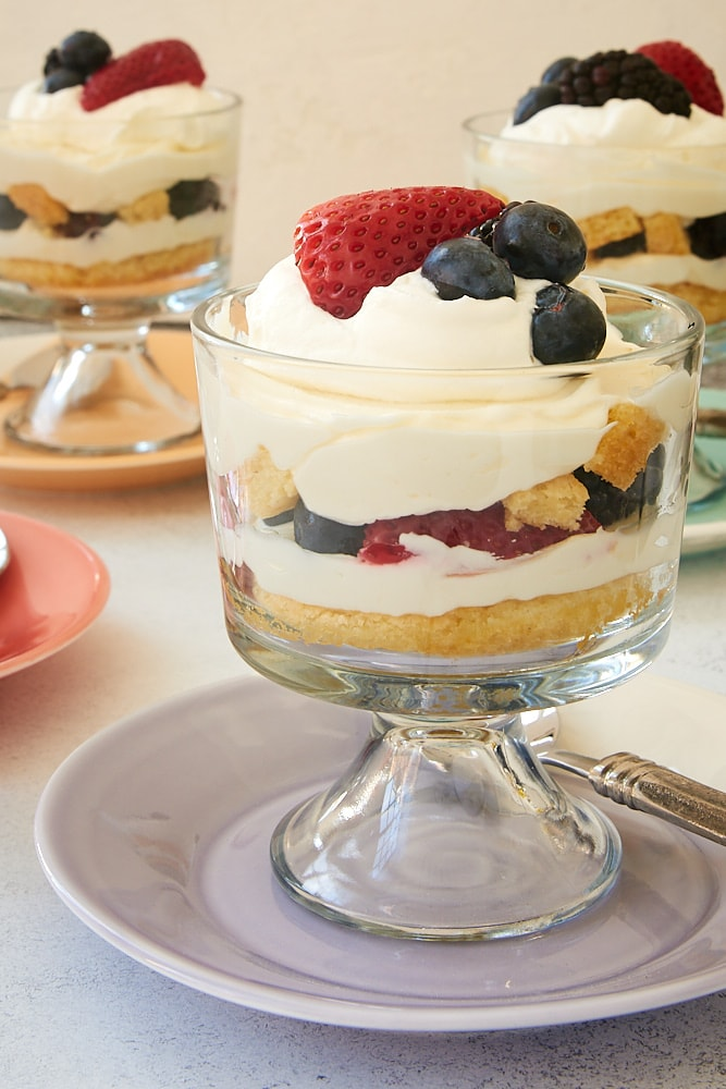 Individual Berry Cheesecake Trifles topped with whipped cream and more berries