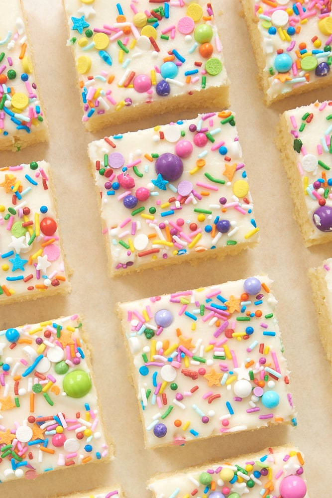 Frosted Sugar Cookie Bars topped with colorful sprinkles