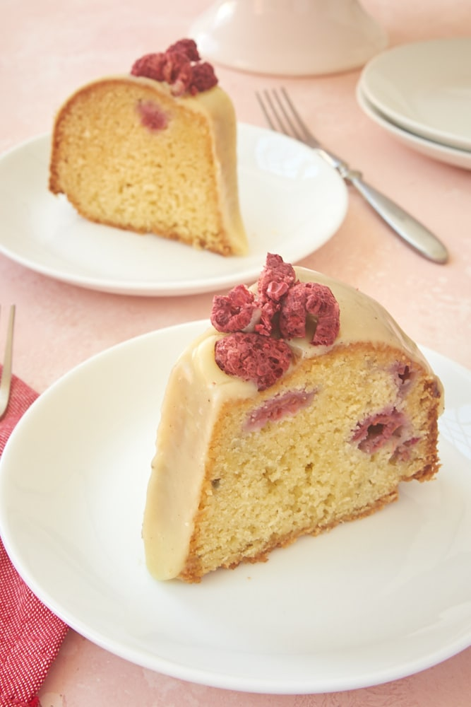 slices of White Chocolate Raspberry Bundt Cake served on white plates