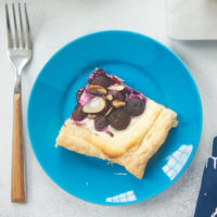 Blueberry Cream Cheese Tart served on a blue plate