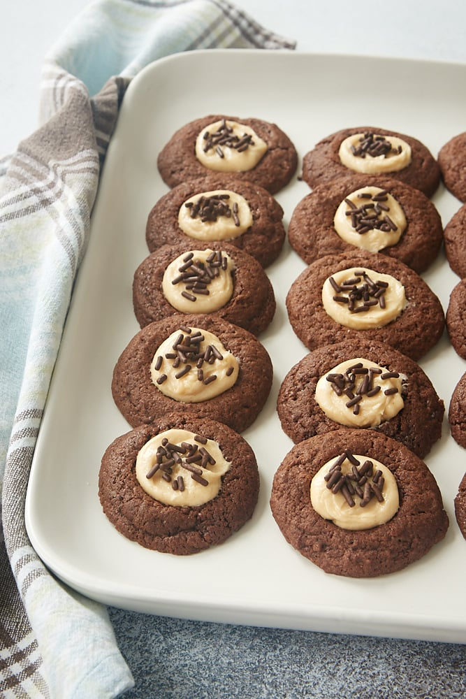 a white tray filled with Chocolate Peanut Butter Thumbprint Cookies
