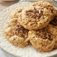Cookie Butter-Stuffed Oatmeal Cookies stacked on a white plate