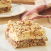 Apple Butter Cream Cheese Oat Bars on a white plate