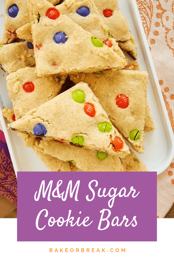 These quick and easy M&M Sugar Cookie Bars are a fun, colorful treat that's sure to be a crowd favorite! - Bake or Break #cookiebars #cookies #M&Ms
