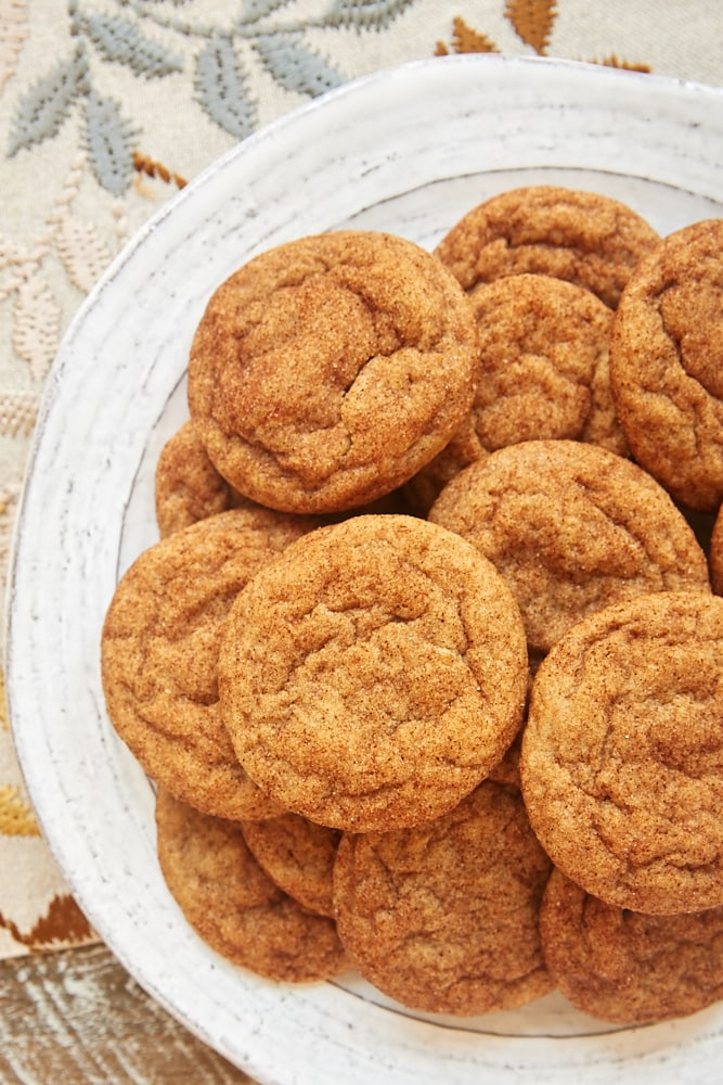 Cookie Butter Snickerdoodles stacked on a white plate