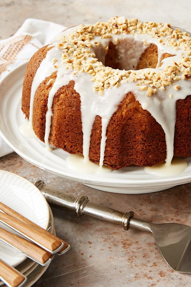 Hazelnut Pear Bundt Cake on a white cake stand