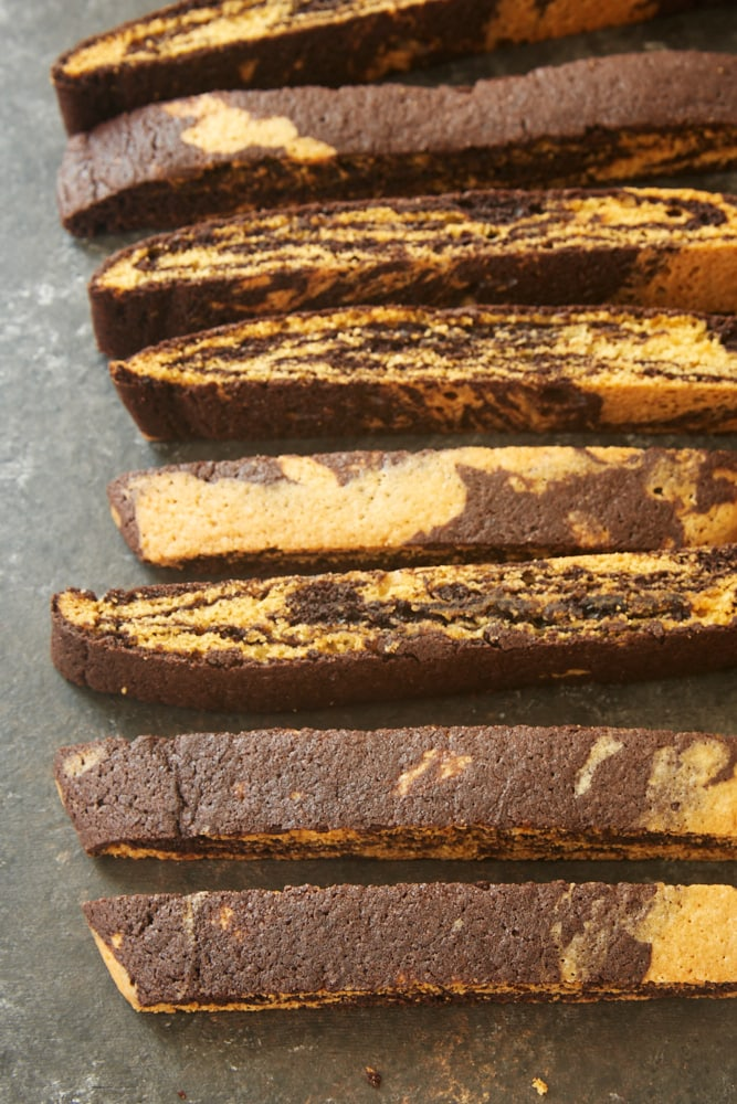 Chocolate Vanilla Marbled Biscotti on a dark surface