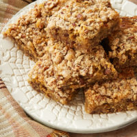 Chewy Pecan Pie Bars stacked on a plate