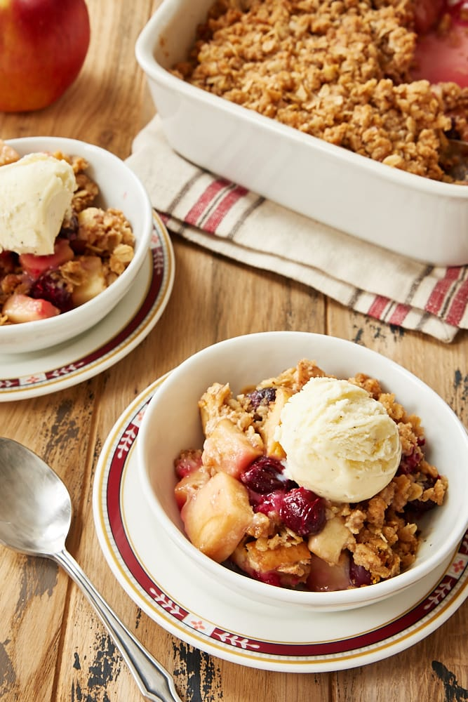 Cranberry Apple Crumble served in white bowls