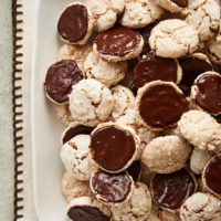 Hazelnut Macaroons piled on a white serving tray